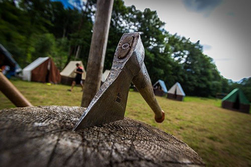 Camp site with camping hatchet